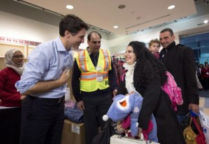 Canada's Prime Minister Justin Trudeau greeting Syrian refugees last night.