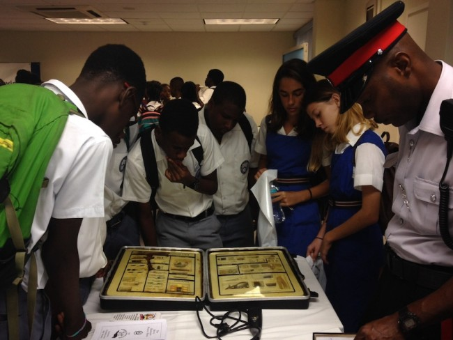 Students taking a closer look at some illegal drugs on display at the Royal Barbados Police Force booth.