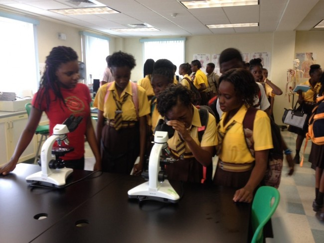 Some of the Princess Margaret Secondary School students at one of the medical science booths.