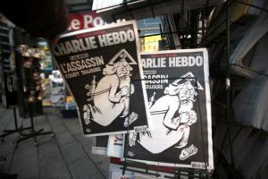 Copies of the latest edition of French weekly newspaper Charlie Hebdo displayed at a kiosk in Nice, France, today.
