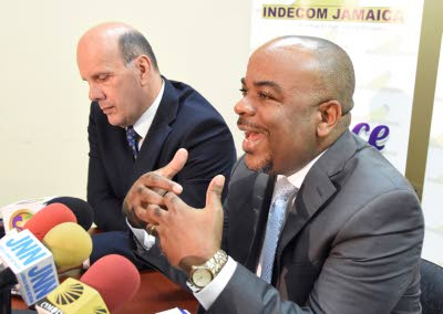 Commissioner of the Independent Commission of Investigations Terrence Williams (right) making a point during a press conference at the agency's offices in New Kingston on Wednesday. Also pictured is Assistant Commissioner Hamish Campbell.