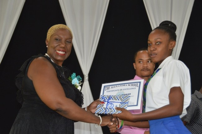 Most Outstanding Girl at the CSEC level, Antoria Cadagon, receiving her award from Alexandra Old Scholars' Association president Sandra Denny.