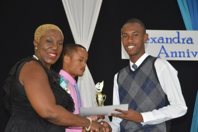 Anmar Goodridge-Boyce receiving an award for his seven subjects at CSEC level.