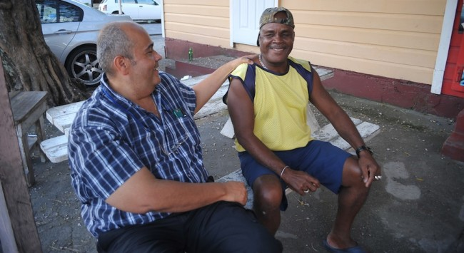 Dr Duguid shares a light moment with Gregston Robberts of 2nd Avenue, Forde's Road.