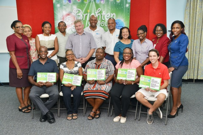 Brighten Your Christmas promotion winner Colleen Hunte (at centre) and People's Choice winner Quinzel Mayers (second from left), along with Hartley Reid, Tracey Grazette, Joshua Worme and the entire promotion team.