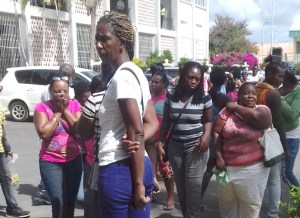 Family and friends of Juvea Cooper outside the May Pen Resident Magistrate's Court yesterday.