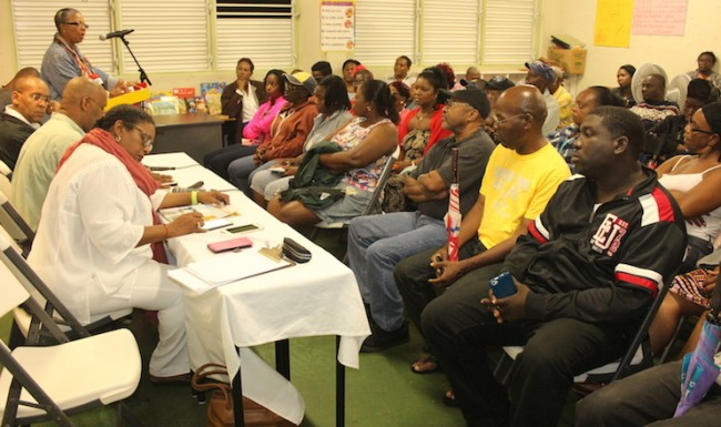 At head table Opposition Leader Mia Mottley along with BLP members Dale Marshall, Kerrie Symmonds (also seated) while Cynthia Forde addresses the audience at last night's town hall meeting at St Bernard's Primary School in Lammings, St Joseph.