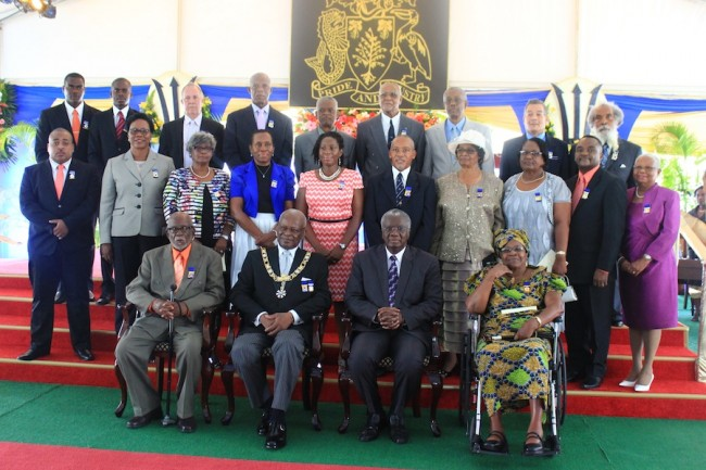 The 21 awardees present took a group photo with Governor General Sir Elliott Belgrave at the conclusion of the ceremony.