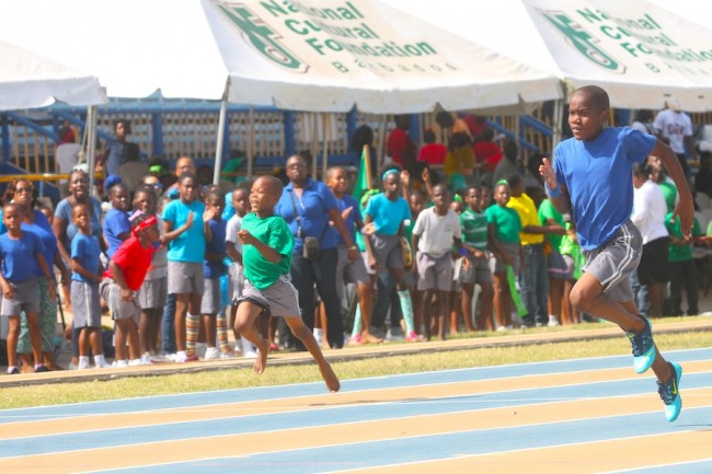 Javier Norville of Blue House (right) had stiff competition from Jaheim Farley of Green House but was able to hang on for the win in the under-nine boys division 150m.