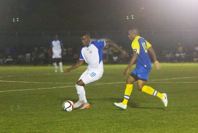 Rendezvous star player Shandel Samuel did well to side step Claytons Kola Tonic Notre Dame Captain Renaldo Gilkes. (Pictures by Morissa Lindsay)