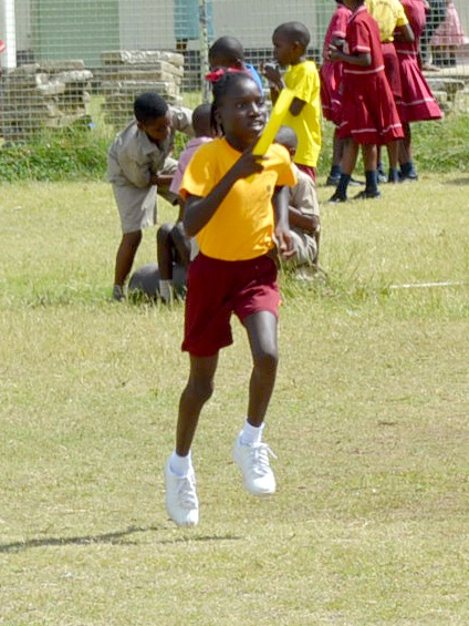 Shonte Seale strides in comfortably ahead of the field to finish in first in the Upper Junior Girls Cross Country relay.