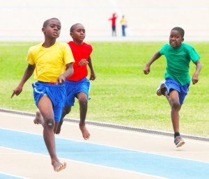 Victor ludorum of Yellow House Raquan Clarke slammed all- comers in the under-11 boys 100m dash, finishing here ahead of Nicholas Cox of Red House.