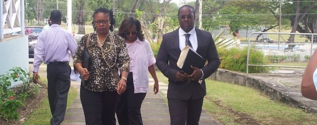 From left, Elecia Weekes, child advocate Shelley Ross and Weekes' lawyer Steve Straughn.