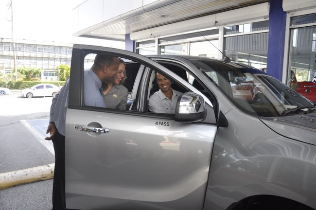 From left, MQI's Nicholas F. Keizer and Margaret Hoyte interacting with the first owner of the 2016 Mazda BT-50.