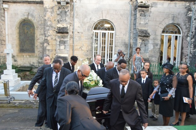 Jean Holder heads the pallbearers who took his wife's mortal remains to its final resting place.