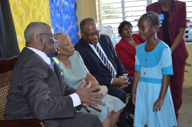 Governor General Sir Elliott Belgrave intereacting with six-year-old Kavitesi Hatege Kimana in the presence of MP for Christ Shurch South John Boyce.