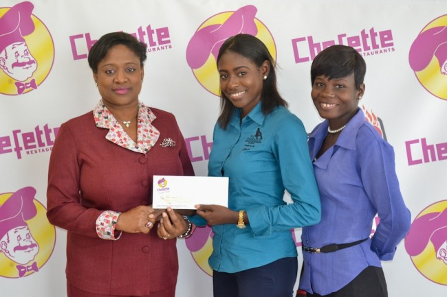 From left, Lisa Carter, Chefette's advertising manager, presenting $3,000 cheque to K'neka Hope, Barbados Vagrants And Homeless Society president's executive  assistant. Looking on is Kimberley Harewood, case manager.