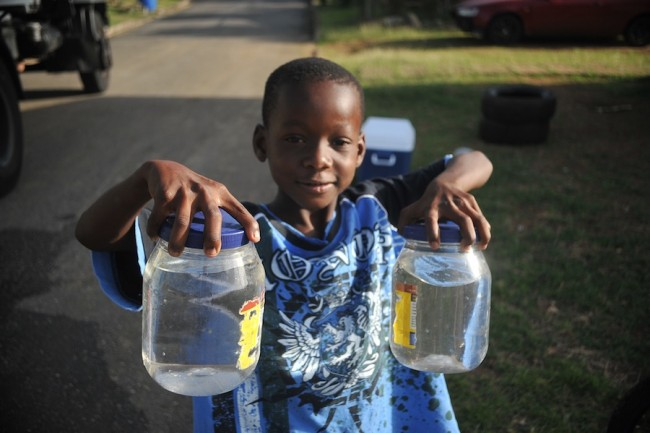 Eight year-old Akio Blackman could only manage these two jars  but he sought to assist his family in fetching water.