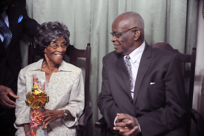 Governor General Sir Elliott Belgrave (right) in  conversation with birthday girl Myril Elaine Howell.