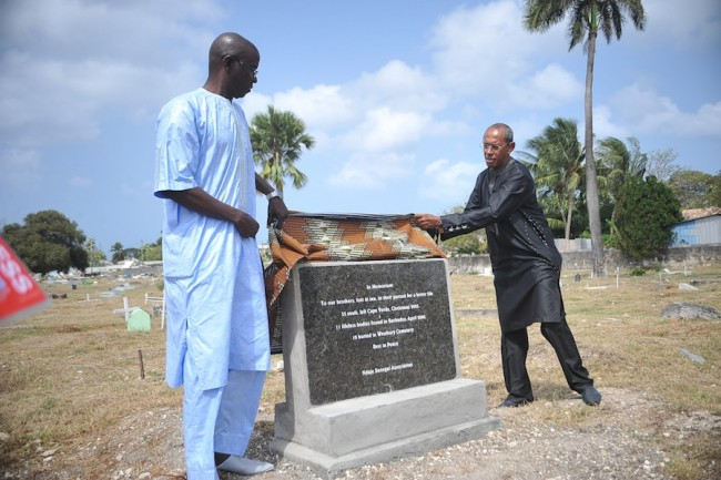 President of the Ndaje Senegal Association Kaly Diedhiou (left) and secretary Emile Angevin unveiling the headstone.