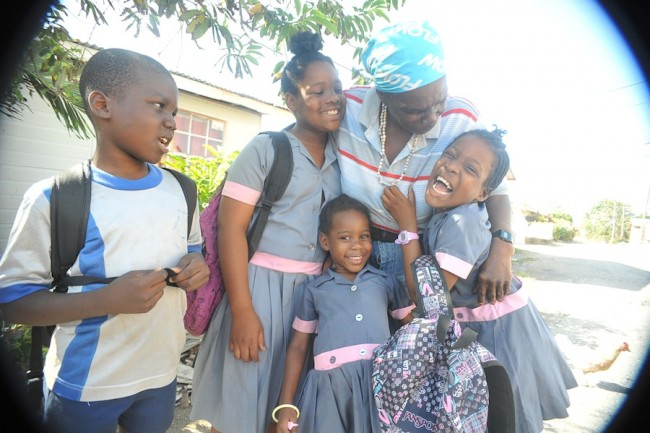 Althea Hinds embraces her grandchildren (from left) Alliston, Kelliston, Ellisha and Kellisha.