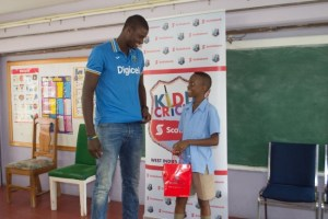 Eden Lodge Primary School cricket captain Darnell Forde gets some tips on the game from West Indies captain Jason Holder.