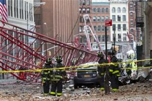 Firefighters working at the scene of a crane collapse in lower Manhattan, New York, today.