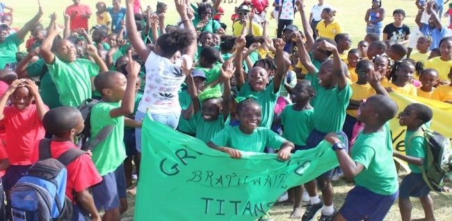 Green House athletes and supporters erupt after being announced as winners of the school sports.