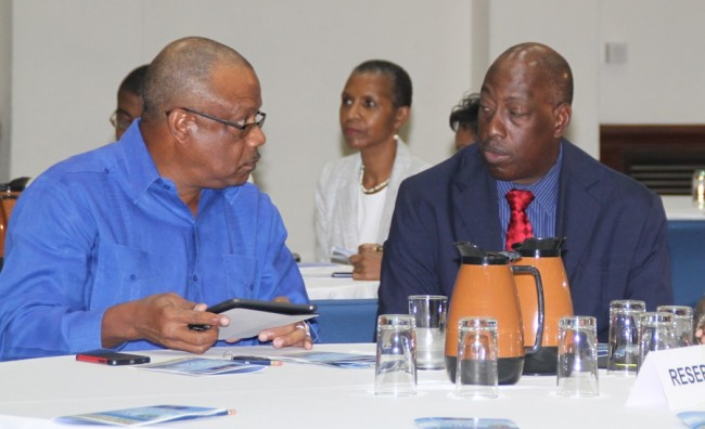 Minister of Health John Boyce (left)  along with the Queen Elizabeth Hospital's Chief Executive Officer Dr Dexter James at the QEH's third annual Health Financing Summit at the Lloyd Erskine Sandiford Centre, yesterday.