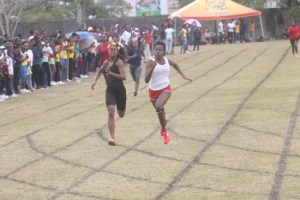 Ka-Neil Gale of Set B (right) won the 200m for Division 1 girls ahead of the fast-finishing Akilah Blackman of Set C.