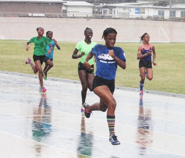 Not even the rain could have stopped the fiery pace that came from senior victrix ludorum Hannah Connell  of Inniss House. (Pictures by Morissa Lindsay)