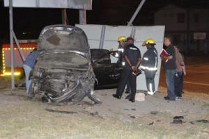 Police and fire officers at the scene of the fatal accident where Adrian Pancho died at Lady Hailes Avenue, San Fernando, early yesterday.