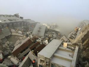 Rescue personnel work on damaged buildings after an earthquake in Tainan, southern Taiwan, today.