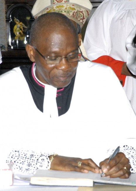 The Very Rev. Dr Jeffrey Gibson, dean of the Cathedral Church Of St Michael And All Angels signing the Book Of Oaths.