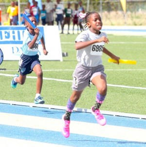 Under-nine queen Tania Applewhaite of St Giles Primary anchored her school to victory in the under-nine girls 4x100m relay.