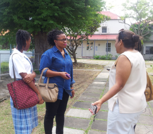 "From left, the student at the centre of the ""wrapper controversy"", her mother Elecia Weekes and child advocate Shelly Ross outside the Ministry of Education today."