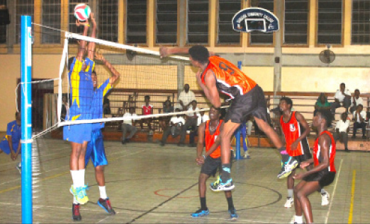 Junior national player Carlos Cyrus goes for another one of his vicious spikes against  Combermere from the outside.