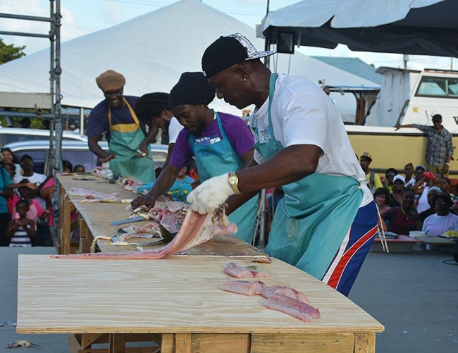 Tyrone 'Dolphin' Shorey (right) emerged winner for the 12th straight year of the keenly contested dolphin skinning competition.