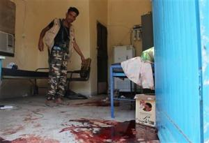 A Yemeni man inspecting an elderly care home after it was attacked by gunmen  in the port city of Aden, Yemen, today.