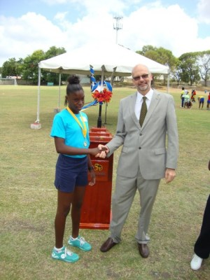 Abigail Mayers receives her 200m gold medal from European Union Ambassador to Barbados and the Eastern Caribbean, Mikael Barford.