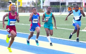Chaz Searles (left) played a crucial role in St Stephen's success on track when he slammed the field in both the under-13 boys 100m and 200m.