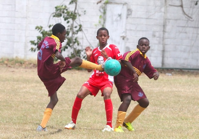 Cosmos pair of Joshua Edwards (left) and Joshua Price (right) had no problems taking possession of the ball in the under-13 showdown against KFC Pinelands Football Academy.