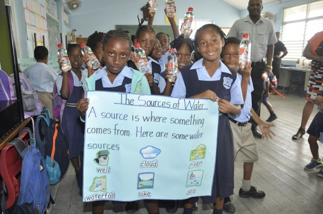 Class 3 students displaying  the sources of water.