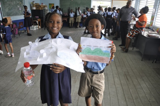 Kirara Hunte and Kemar Quarless displaying their illustrations for  the water project.