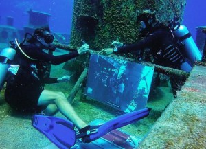 Divers mount one of several photos for the Kittiwake's fifth anniversary of the sinking celebratory underwater museum.