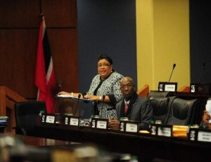 Former housing minister Marlene McDonald speaking at a recent session of Parliament while Prime Minister Dr Keith Rowley listens.