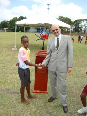 Jayquon Blades was another winner in the Division 17  200m and is congratulated by Ambassador Mikael Barford.