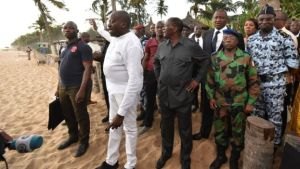 President Ouattara (centre) visited the beach resort after the attack.
