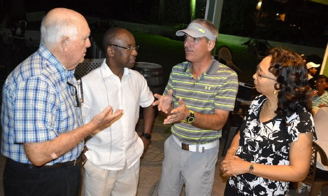 Robert Peirce (second from right) conversing with Dave Barnard, Minister of Sport Stephen Lashley and Betty-June Leacock.