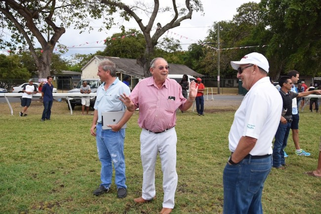 Sayler's Creek owner Ken Ramsey (centre) makes a point to trainer of War Envoy Wesley Ward (left) as well as its owner Derek Smith (right).